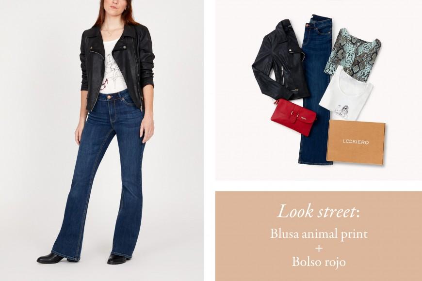 look jeans flare con blusa animal print y biker